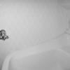 洗面台の水が跳ねそうな部分にはキッチンパネルを貼る